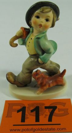 "An adorable porcelain figurine featuring a young boy in mid stride with a parasol / umbrella over his shoulder and his dog at his feet. The bottom of the base has a blue stamp with the Goebel trademark 6 along with the artist's initials in black under the glaze. Incised on the rim of the base is ""M. I. Hummel"". This figurine was permanently retired in 1989. Figurine measures 4.75"" tall. Free of chips, cracks, repairs and crazing. #Home #Décor #Collect #POGAuctions"