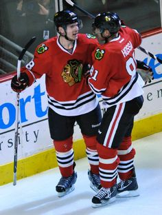 Chicago Blackhawks' Ben Smith (28), celebrates with teammate Marian Hossa (81), after scoring during the third period of an NHL hockey game against the St. Louis Blues in Chicago, Wednesday, March, 19, 2014. Chicago won 4-0. (AP Photo/Paul Beaty)