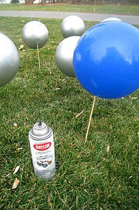 Paint cheap bouncy balls to make oversized lawn ornaments. | 29 Ways Spray Paint Can Make Your Holiday Decor Look Expensive