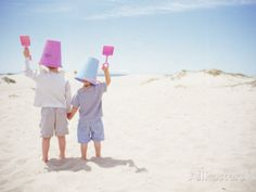 2 Boys with Sand Bucket Over Their Heads Photographic Print by Jeff Greenberg at AllPosters.com