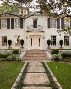 Stunning white brick home exterior with Juliet balcony accented with iron railing over entry door flanked by sidelight windows and black lan. (welcome decor curb appeal) Traditional Home Exteriors, Traditional House, Traditional Landscape, Exterior Design, Interior And Exterior, Black Exterior, Exterior Paint, Modern Interior, My Dream Home