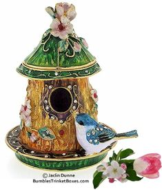 Lovely bird jewelry holder. 'Bluebird house' design. Trinket box has a hinged lid and a magnet closure.