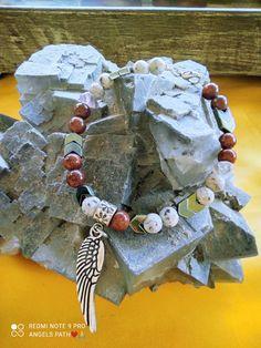Χειροποίητο ενεργειακό βραχιόλι με ενεργειακές ημιπολύτιμες πέτρες απο μηλοκόραλο , αιματίτη σχέδιο και λευκό jade με σχέδιο μεταλλικά φτερά αγγέλων . Ιδιοτήτες :Χαρίζει ενέργεια και δύναμη και αυτοπεποίθησh , αναζωογονεί τον οργανισμό μετά από μια μακρά περίοδο ασθένειας η υπερκόπωσης Jade, Jewelry, Jewlery, Jewerly, Schmuck, Jewels, Jewelery, Fine Jewelry, Jewel