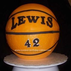 Homemade  Basketball Cake Idea: To make this Basketball Cake Idea, you will need three round cakes, one 10 round Styrofoam ball, buttercream frosting, 10 round cake board, and fondant.
