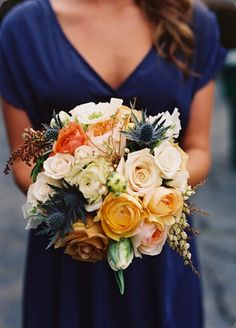 Orange roses and blue thistle.