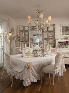 White Shabby Chic shutters flanking a mirror..love how they did it....white, feminine dining room