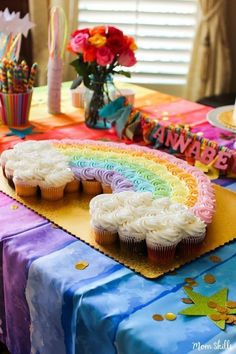 Make rainbow cupcakes into a cake! Follow the rainbow to a land far away for an adorable unicorn birthday party. If you're scouring the internet for unicorn party ideas, look no further! #Rainbows