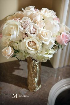 White wedding bouquet with the hint of soft pink i think is beautiful;