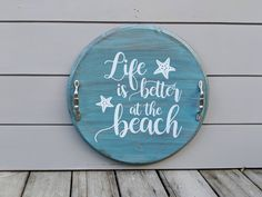 """""""We offer FREE ground shipping to the contiguous US Only Shipping carrier will be either USPS, UPS or FedEx which we will determine by your mailing location This hand crafted round serving tray measures approximately 17.5x1 inches. The tray has a routed edge to accent the design, with the phrase, \""""Life is better at the Beach\"""". Tray has been sanded, stained, hand painted and distressed to create a weathered antique look. Primary color is \""""Vintage Aqua\"""", and the lettering is White, and painted Wood Projects That Sell, Diy Wood Projects, Wood Crafts, Serving Tray Wood, Wood Tray, Round Wooden Tray, Lazy Susan, Diy Signs"""