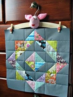 Quilt Block - nice for using up various scraps while having lots of another solid color (which I do!)