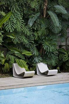 "madabout-garden-design: "" The garden of artist Tomie Ohtake's house, in Sao Paulo. ""Outside, the lines minimalists extend almost like an organic being into the lush garden, consisting of tropical species and a good collection of sculptures."" See the..."
