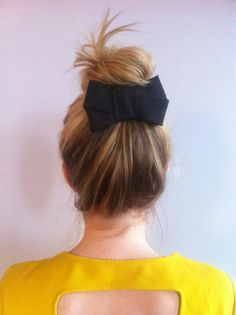 Self-done bun {via my twitter feed - @MerciNYC}. Hair color from Jerami Brown at Paul Labrecque.  Bow is from J. Crew. www.mercinewyork.blogspot.com