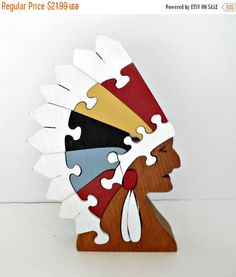 Beautiful handmade hand-painted Native American Indian chief headdress wooden puzzle home decor piece this piece measures 8 1/2 inches ltall