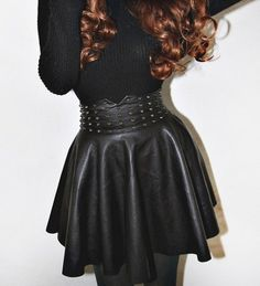 Black faux leather mini skater skirt with spikes studs Fit Sizes XS-M.  Stretches around the waist - $45