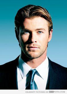 Chris Hemsworth - Good looking Chris Hemsworth portrait photo with blue eyes wearing a suit.
