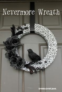 Halloween Nevermore Wreath - As much as I love Edgar, I would never hang a stuffed bird on my door. I like the rest though