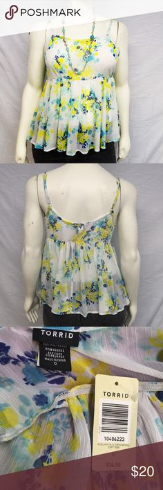 Torrid Chiffon Spring Floral Tank Gorgeous spring floral babydoll tank top from torrid! The sheer chiffon material is perfect for a warm day. Blue and yellow floral print. The babydoll style is perfect for all body types. New with tags, never worn. Undamaged. Smoke and pet free home. Bundle and save! torrid Tops Tank Tops