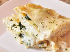 white lasagna with basil and spinach