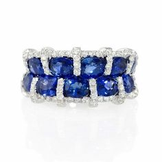 NEW: Ring featuring ten oval cut blue sapphires 5.46ctw accented by white diamonds .58ctw in 18k white gold
