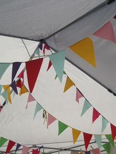 Bunting adds a fun touch to a plain old tent. {craft booth setup}
