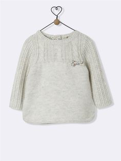 This is absolutely gorgeous. First of all - I love fabric lined knits. This is the next level - it has a detail of the same fabric in front. Beautiful combination of simple stitches.