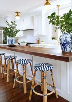 rattan counter stools with blue and white