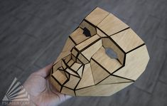 """""""Designed to resemble pepakura, this low poly mask was cut from wood and is attached using a folded paper base. Cardboard Costume, Cardboard Mask, Low Poly Maske, Paper Origami Flowers, Laser Cut Box, Woodcut Art, Polygon Art, Wax Carving, Paper Mask"""