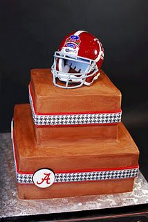 I like the touch of red on ribbon in this groom's cake but not the overall look of the chocolate on it.