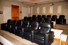 Eagle Crest Estate presents an entertainment level that features a seventeen seat multi-level theater with electronically controlled recliner seating and theater lighting.