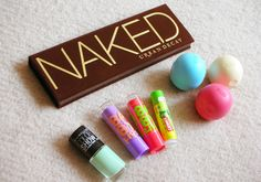 The best makeup products. Baby lips, Naked Urban Decay eye shadow palete, Color Show nail polish by Maybelline & EOS lipbalm.