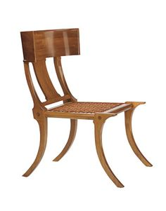 This is a walnut klismos chair made in the 1960s for US furniture designer T.H. Robsjohn-Gibbings.
