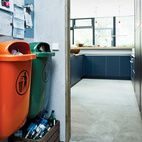 Bring In the TrashWith an eye for the industrial, Winterhalder built the garbage area in the kitchen around two standard-issue plastic trash cans common in German cities. One is orange; the other, green. These in turn inspired her to start adding color accents around the house.  Photo by: Mark Seelen