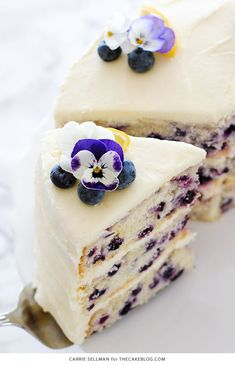 Tender butter cake with brightened with lemon juice, lemon zest and wild blueberries, frosted with a tangy sweet lemon cream cheese frosting.