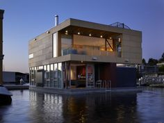 modern BOATS | This sleek, stylish modern house boat on the eastern shore of Seattle ...