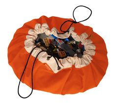 A drawstring bag that opens to a playmat; I wonder if I could sew something like this? Swoop Orange-Crush