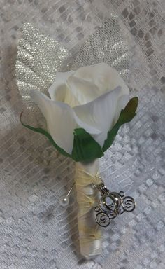 Boutonniere for a Cinderella-themed wedding by http://couturekeepsakes.com/