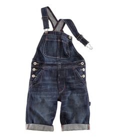 Overalls in washed denim with adjustable straps. Divided chest pocket, and side and back pockets. Buttons at sides and sewn, cuffed leg hems