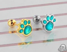 Show off your love for your four legged friend with these adorable blue opal paw print barbells! Barbell Earrings, Cartilage Earrings, Tragus, Stud Earrings, Pawprint, Blue Opal, Body Jewelry, Bronze, Rose Gold
