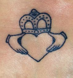 Me & my sisters matching claddagh tattoo.