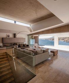 Concrete house by Felipe Assadi slopes along Chilean coast