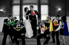 Superheroes wedding photo - Wedding picture where the bride and bridesmaids expose Superhero dresses under the suits of the groom and other men.