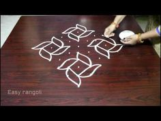 Beginners kolam designs with 9 dots Simple Rangoli Kolam, Easy Rangoli Designs Diwali, Simple Rangoli Designs Images, Free Hand Rangoli Design, Rangoli Ideas, Rangoli Designs With Dots, Rangoli With Dots, Beautiful Rangoli Designs, Simple Designs