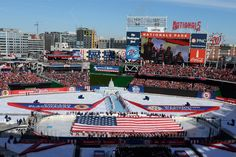 Service members take part in a flag ceremony on the ice in Nationals Park, Washington, D.C., before the start of the 2015 Bridgestone NHL Winter Classic hockey game between the Washington Capitals and Chicago Blackhawks, Jan. 1, 2015. The National Hockey League paid tribute to the U.S. Armed Forces during pre-game and in-game festivities. hires_150101_EJ_001a.jpg (1420×947)