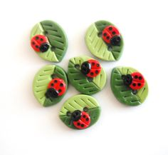 Button Summer Leaves with Ladybugs handmade polymer clay buttons ( 6 ). $8.50, via Etsy.
