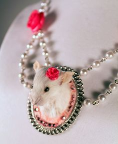 (THIS is the coolest thing I've seen in a LONG time...so perfect. so weird.) Taxidermy Mouse 'Game Head' Style Necklace by MorbidCurioTaxidermy, $125.00 @Eileen Bower