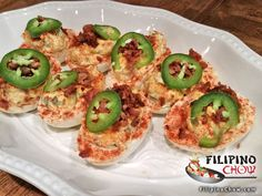 This is Jalapeno Cheddar Bacon Deviled Eggs. This is an interesting twist on a holiday classic that is sure to impress. Deviled eggs were always one of my favorites at Thanksgiving and Christmas feasts.   RECIPE: https://goo.gl/9dS7R1