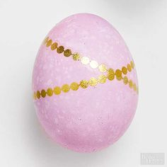Easter eggs never looked so fierce. To get the glamorous look, trim the edges of a metallic temporary jewelry tattoo. Remove film and place tattoo facedown on a dyed hard-boiled egg. Pat the back of the tattoo with a damp (not wet!) paper towel. Wait a few seconds, then peel off the paper backing. Gently press down on any loose edges, sealing them to the egg's surface. Allow egg to dry completely./