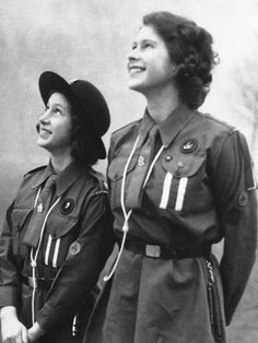 Britain's Princess Elizabeth, right, and her sister, Princess Margaret as they watch their carrier pigeon circle in the sky after they have released it with a message for Lady Baden-Powell on 20 Feb. 1943