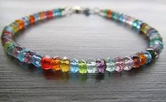 ~shimmery multicolored semi-precious gemstones make up this fun rainbow bracelet~finished with a sterling silver lobster clasp~perfect birthstone bracelet (january, february, august, and november)~By earthwatersol. $42.00