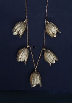 $54 Gold Tulip Necklace. I wish there were earrings in this style.